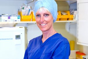Exeter Colorectal Surgeon Miss Patricia Boorman in Scrubs